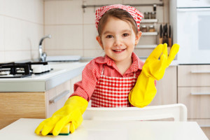 Little-girl-cleaning-table